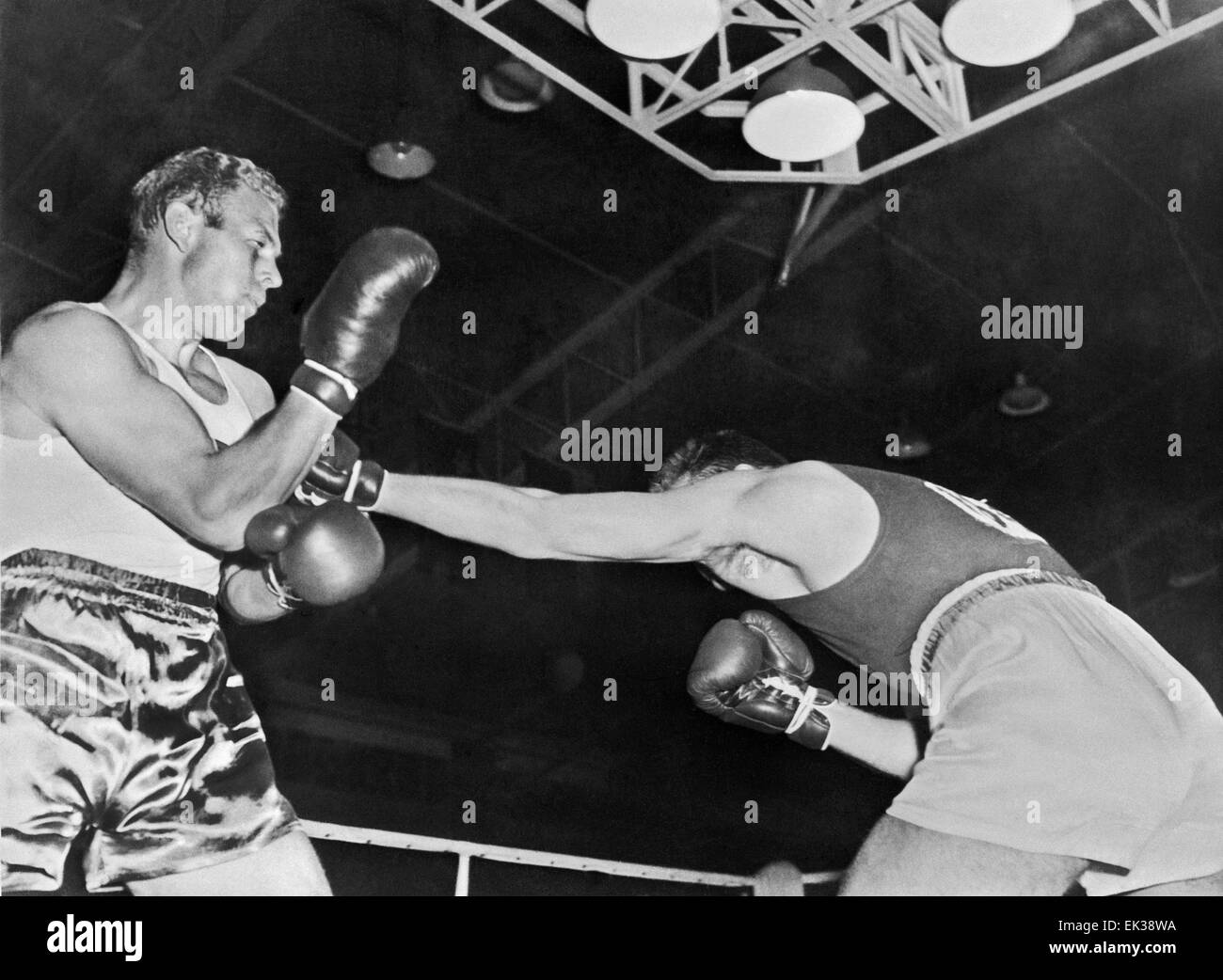 MELBOURNE, AUSTRALIA. The 1956 Summer Olympics. Soviet boxer Lev Mukhin (R) and Swedish Thorner Ahsman. - Stock Image