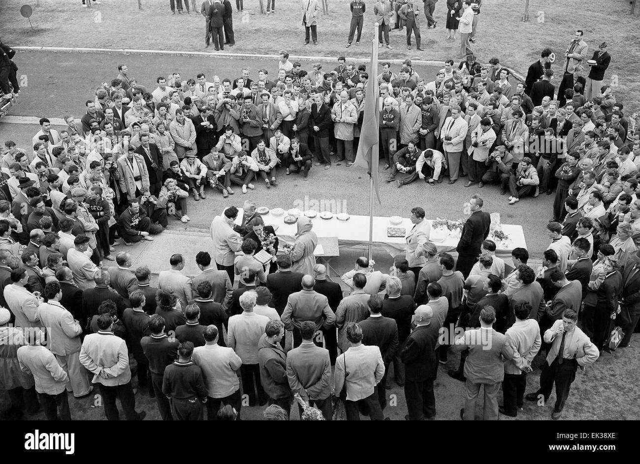 Australia. Melbourne. 1956 Summer Olympics. Head of the Soviet delegation N. Romanod presents cakes to Soviet medal - Stock Image