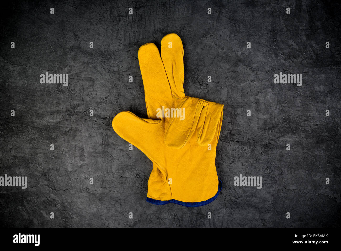 Yellow Leather Construction Engineer or Builder Working Protective Gloves Making Three Fingers Gesture. - Stock Image