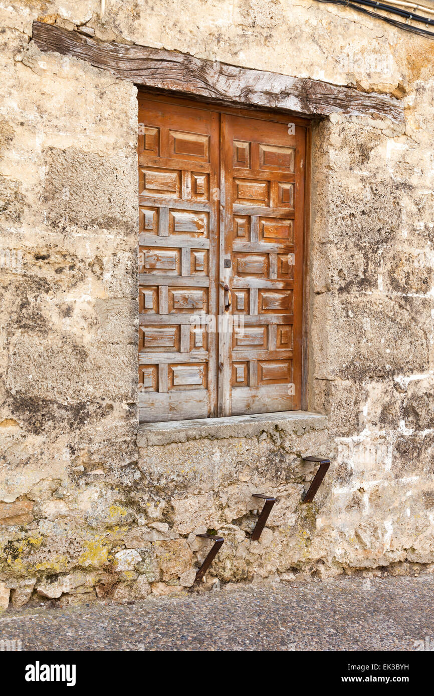 Old rural building with elevated door difficult to access - Stock Image