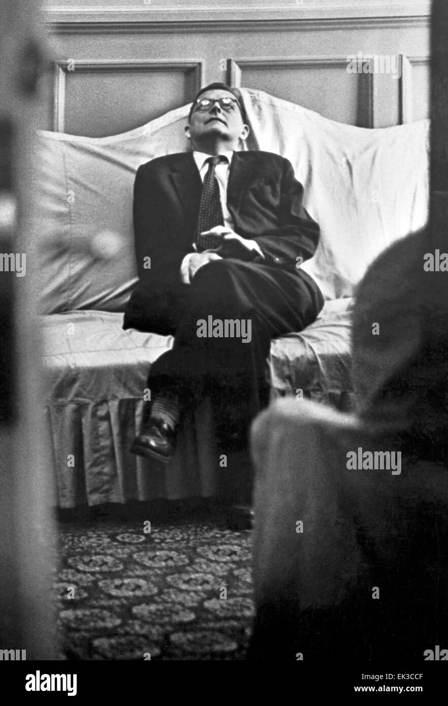 Dmitry Shostakovich sits on a sofa during his symphony premiere. - Stock Image