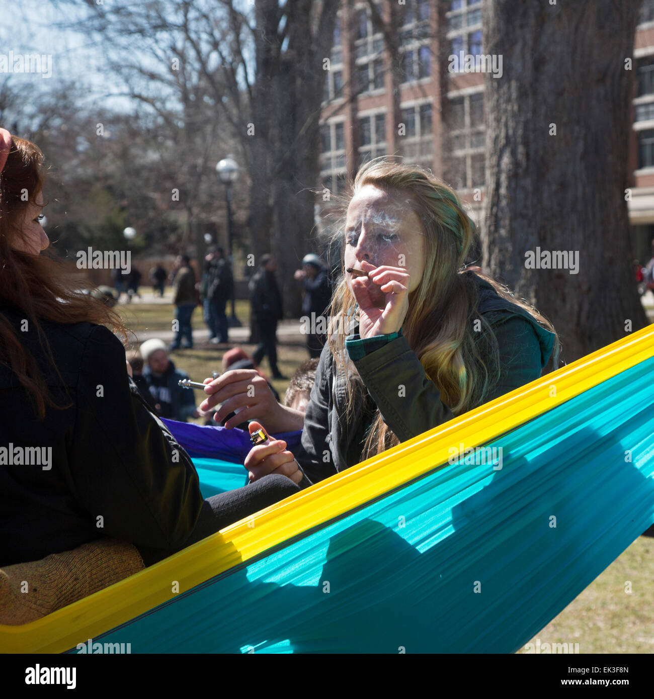 The annual Hash Bash at the University of Michigan, where a lot of marijuana is smoked and speakers call for its - Stock Image
