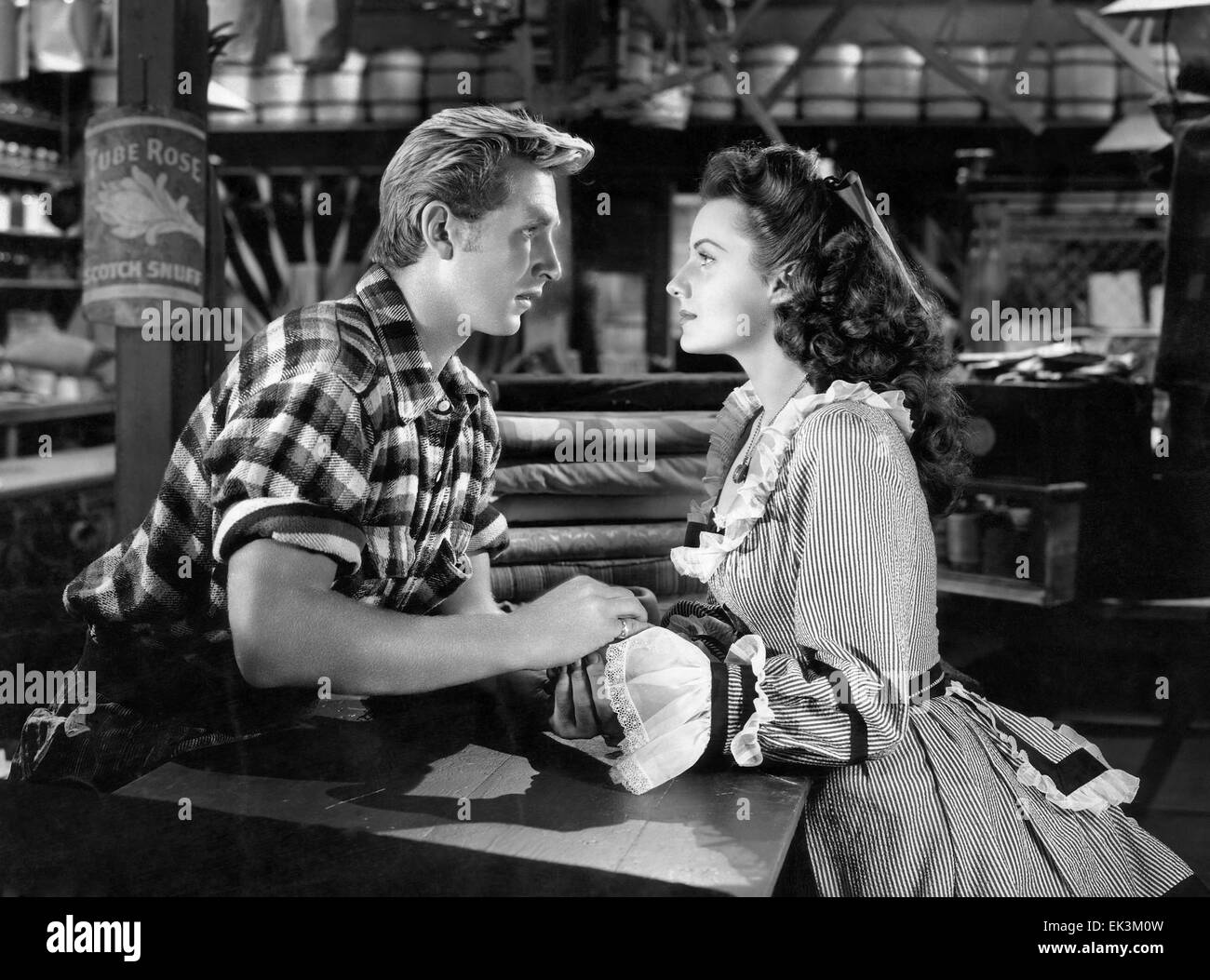 Lloyd Bridges, Rhonda Fleming, on-set of the Film 'Abilene Town', 1946 - Stock Image
