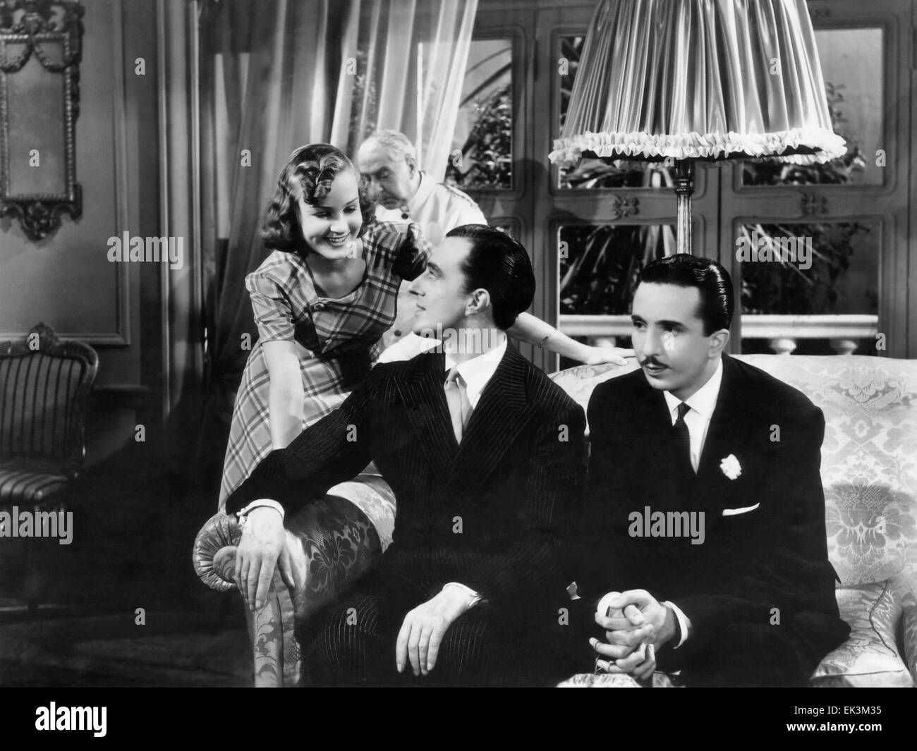 Vittorio De Sica, (center), on-set of the Film 'Do You Like Women' (aka Teresa Venerdi), 1941 - Stock Image