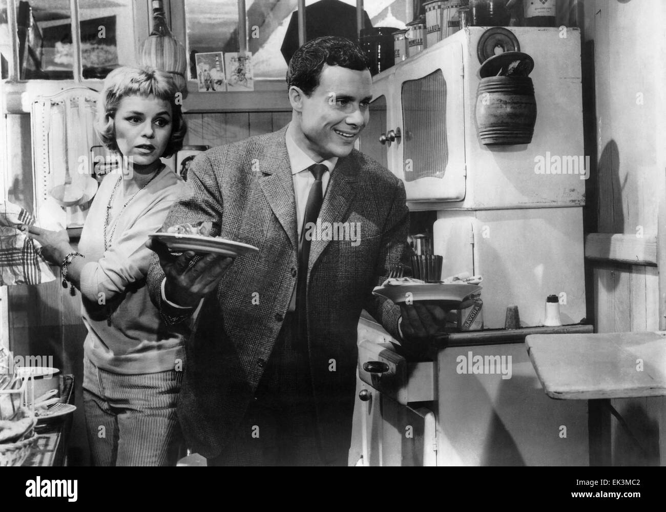 """Genevieve Cluny, Jean-Louis Maury, on-set of the Film """"The Love Game"""" (aka Les Jeux de L'Amour), 1960 Stock Photo"""