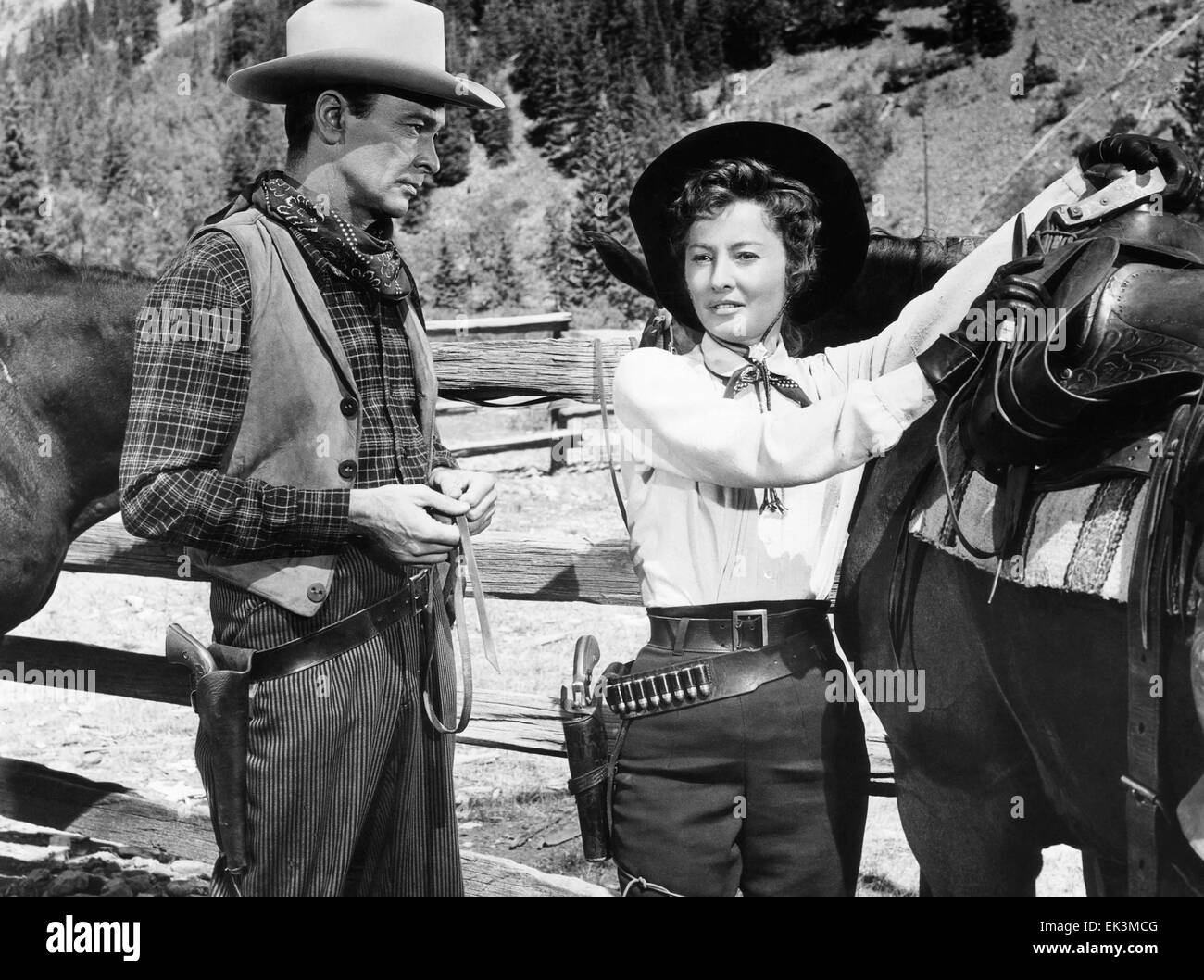 Barry Sullivan, Barbara Stanwyck, on-set of the Film 'The Maverick Queen', 1956 - Stock Image
