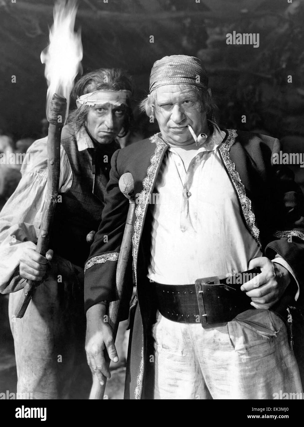 Wallace Beery, (right), on-set of the Film 'Treasure Island', 1934 - Stock Image