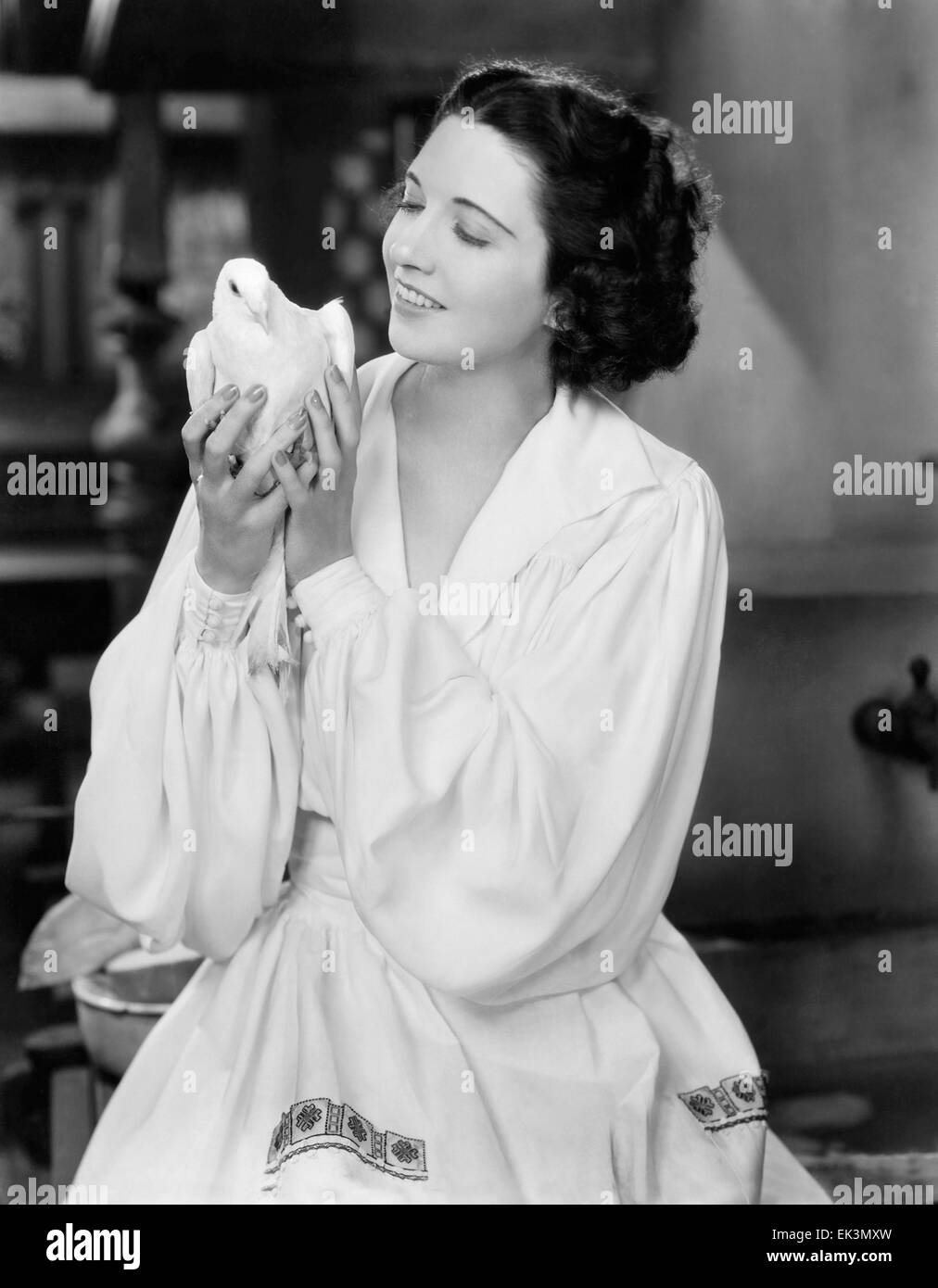 Kay Francis, Portrait, with Dove, circa mid-1930's - Stock Image
