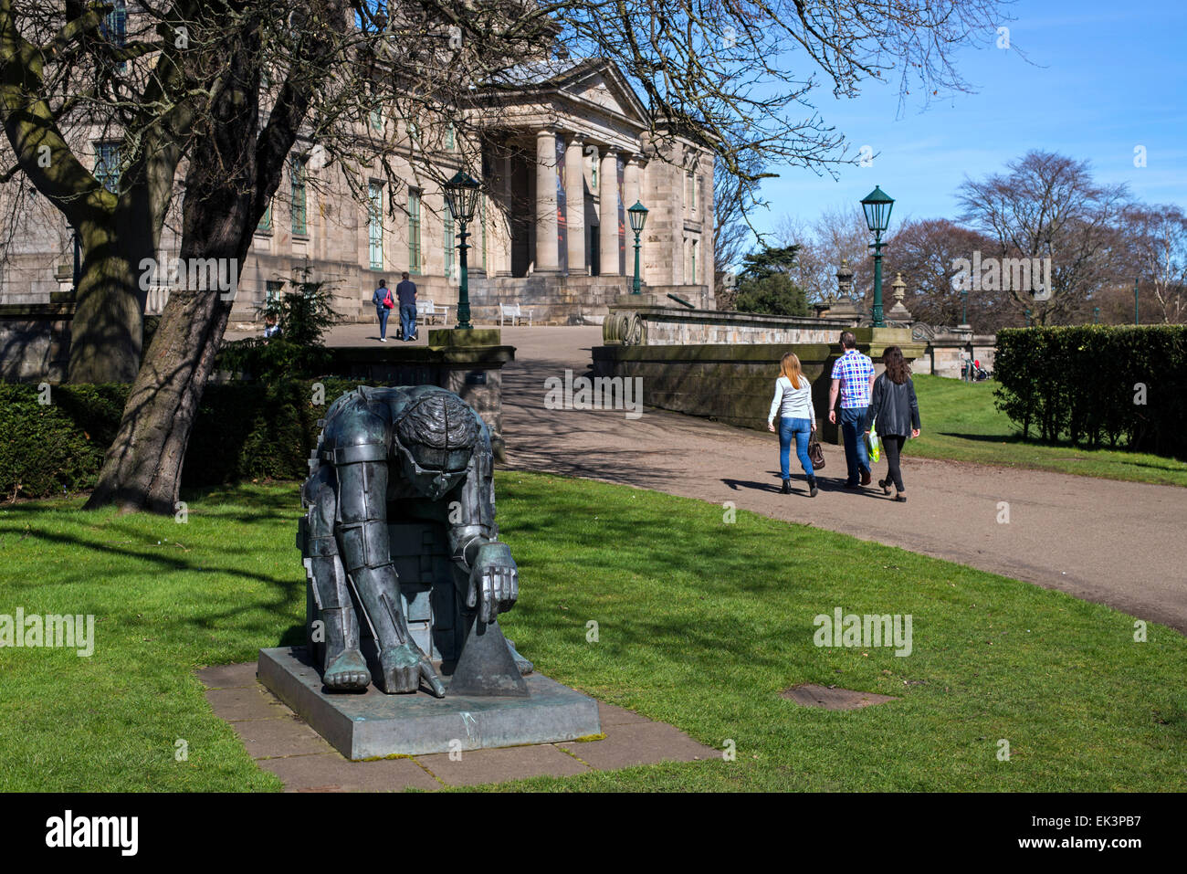 Visitors walking by the figure of Sir Isaac Newton by Sir Eduardo Paolozzi at the entrance to the Gallery of Modern - Stock Image