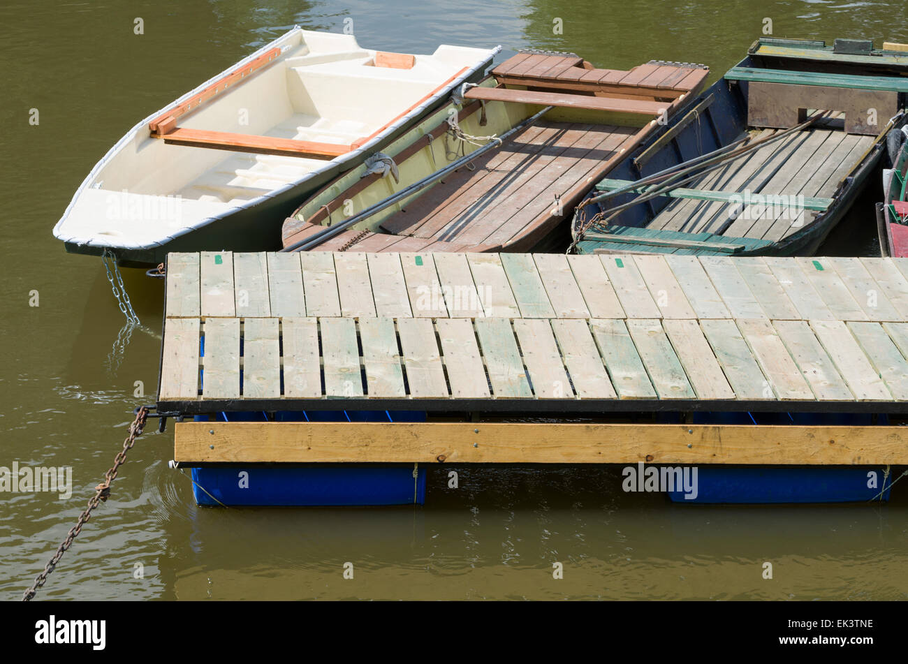 Boats Moored with Iron Chains to Floating Pier on the River - Stock Image