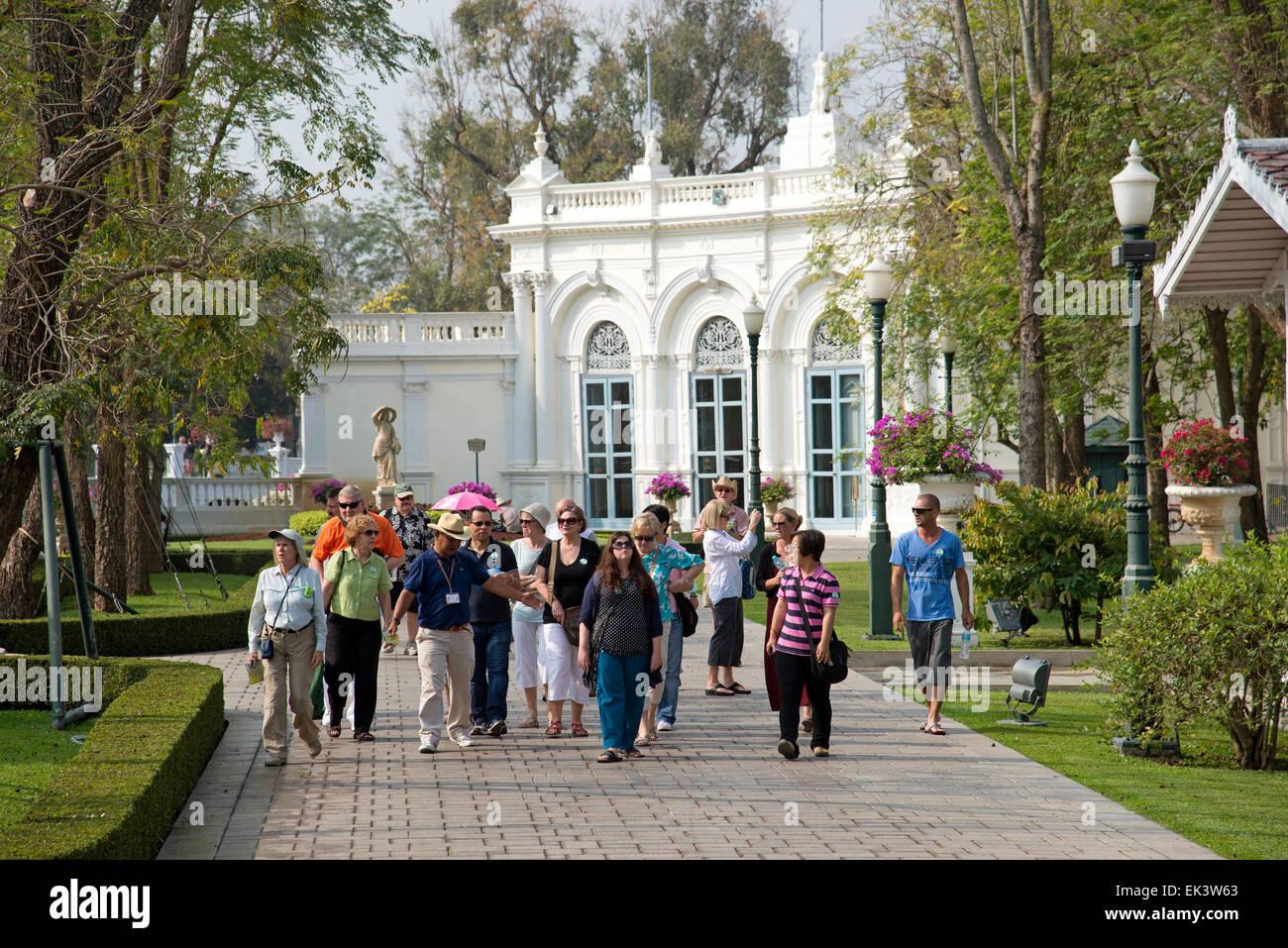 Tour guide with a party of visitors at Bang Pa in Palace at Ayutthaya Thailand - Stock Image