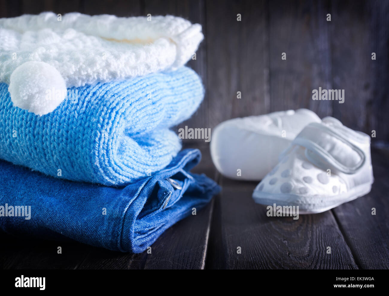 baby clothes for boy on the wooden table - Stock Image