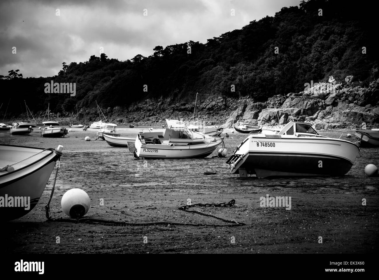 boats in harbor at low-tide - Stock Image
