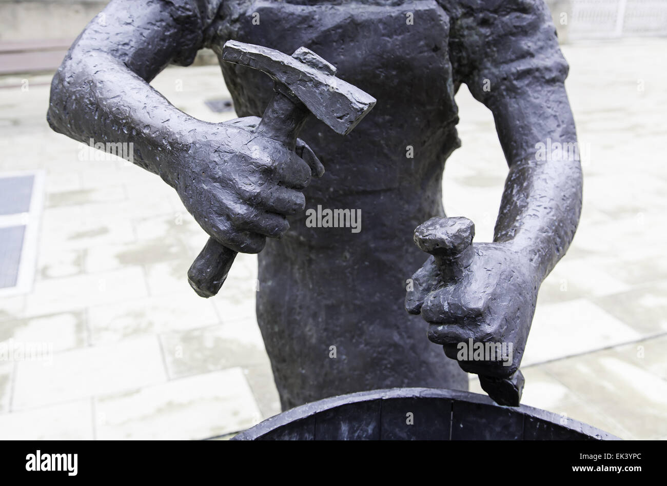 Bronze statue with a hammer, detail of a statue of a worker Stock Photo