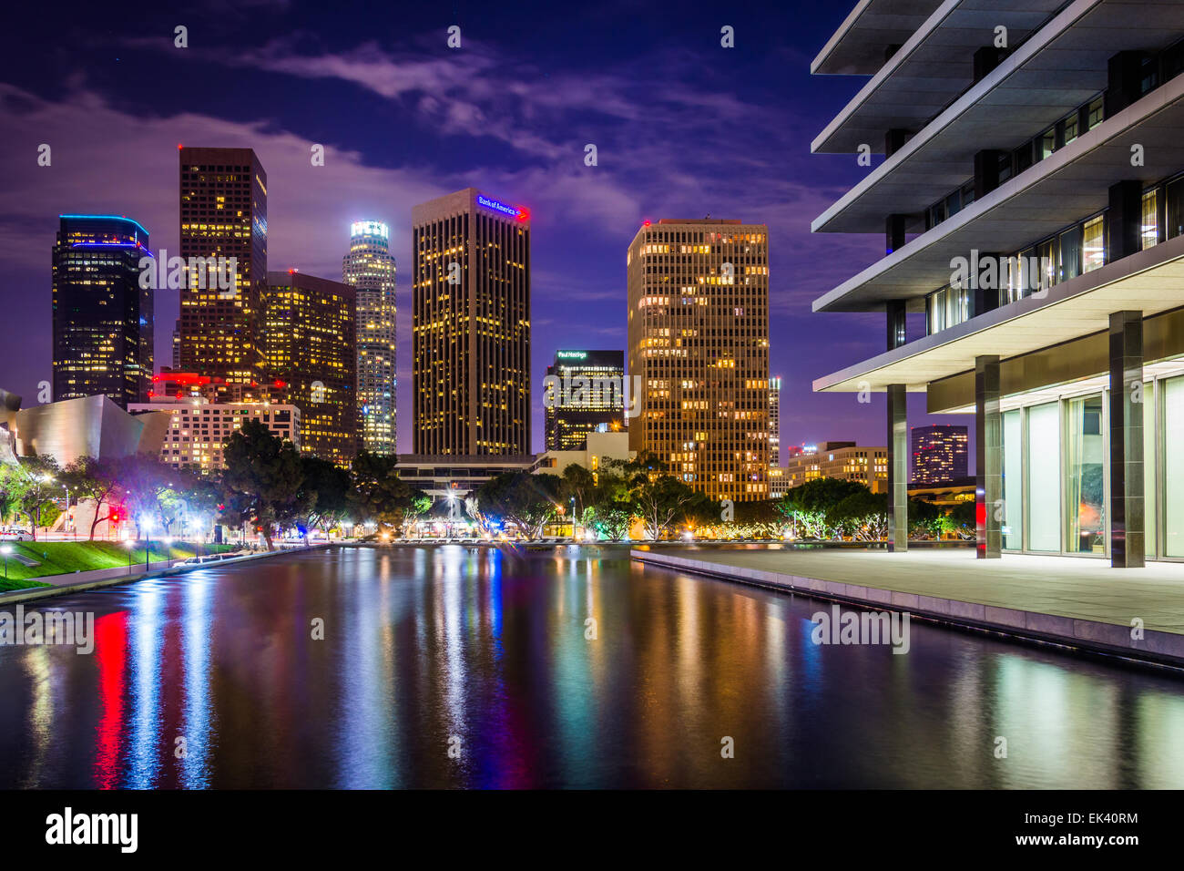 The Los Angeles Department of Water and Power Building and the downtown Los Angeles skyline at night, in Los Angeles, Stock Photo