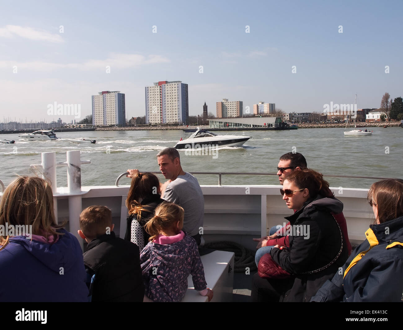 Tourists enjoying a guided trip around Portsmouth harbour onboard a harbour tour boat - Stock Image
