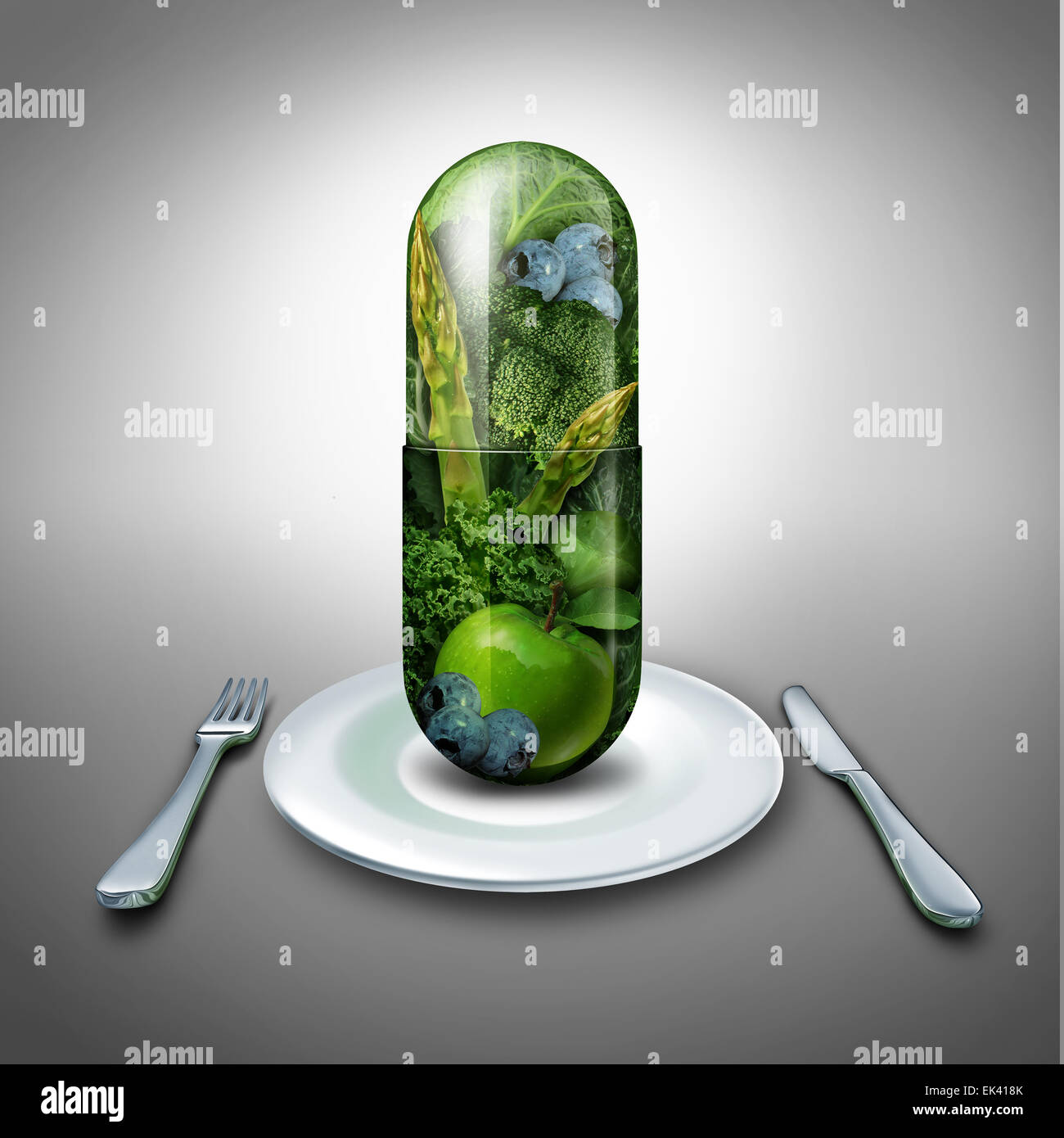 Food supplement concept as a giant pill or medicine capsule with fresh fruit and vegetables inside on a table place - Stock Image