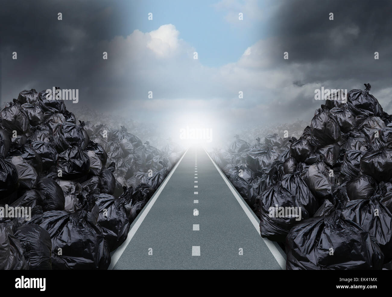 Garbage solution environmental concept as a straight road or clear path cutting through a background with garbage - Stock Image