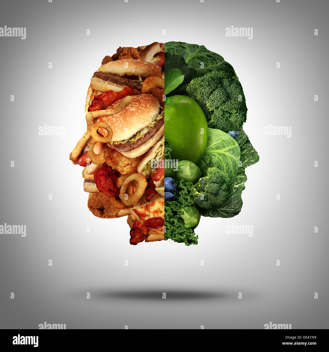 Food concept and diet decision symbol or nutrition choice dilemma between healthy good fresh fruit and vegetables - Stock Image