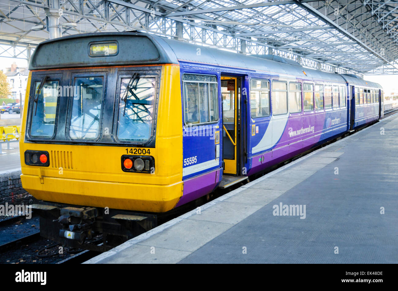 Railbus style 'Pacer' diesel multiple unit train operated by Northern Rail, waiting at a railway station - Stock Image