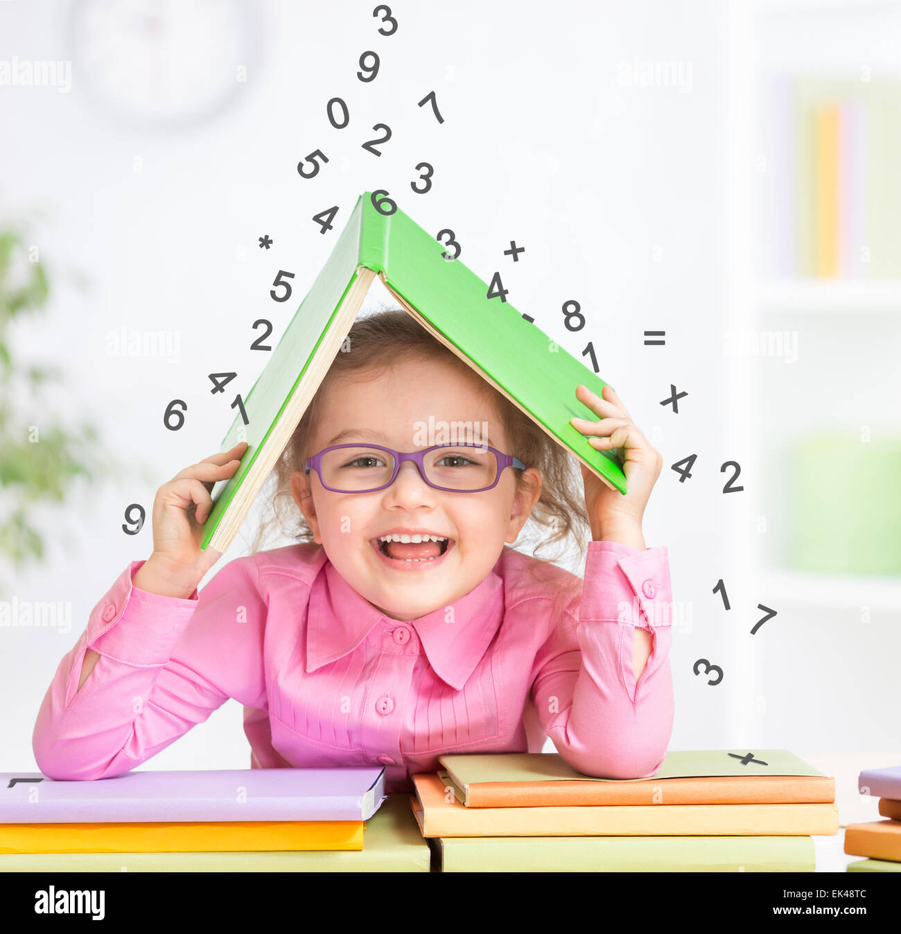 Smart kid in glasses under falling digits - Stock Image
