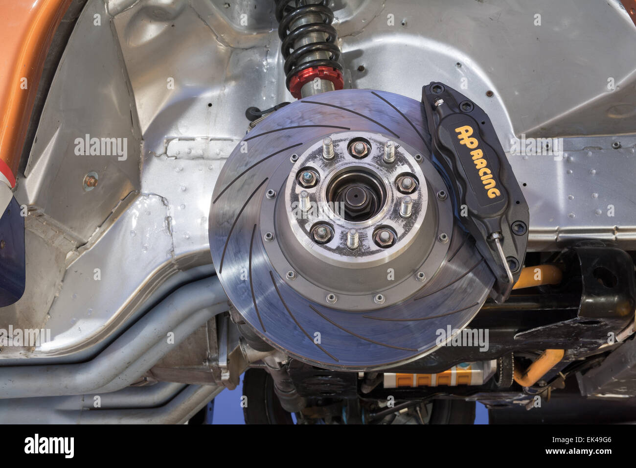 Car brake disc and caliper on a vehicle modified for motor sport. - Stock Image