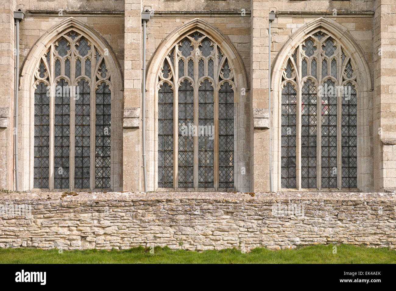 Trio of medieval windows on the southe side of the church of St Mary and All Angels, Fotheringhay, England, built - Stock Image