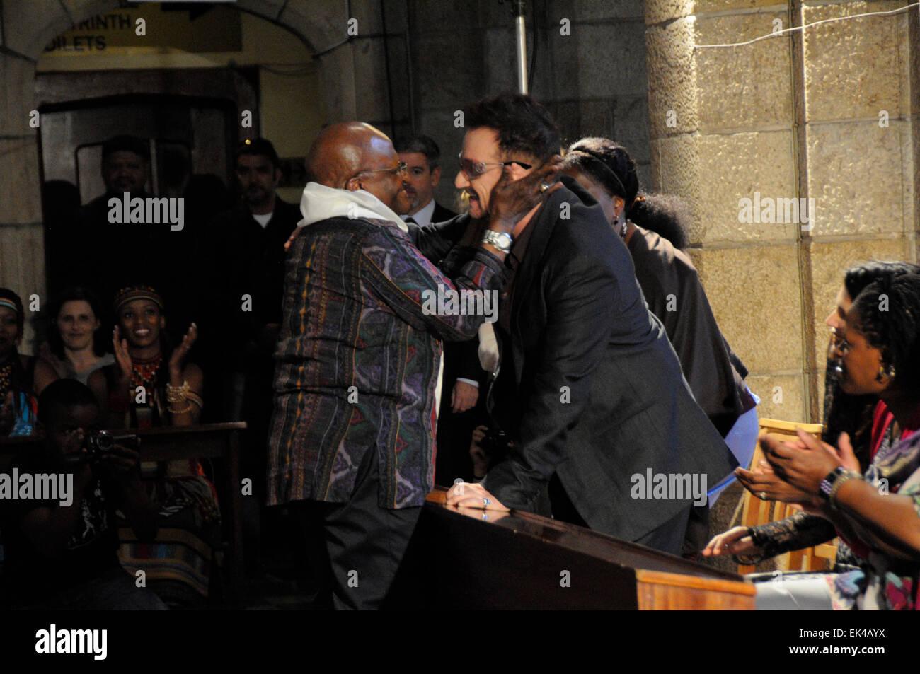 Archbishop Desmond Tutu hugs Irish Rock Star Bono at the book launch of Tutu,The Authorised Portrait during a week - Stock Image