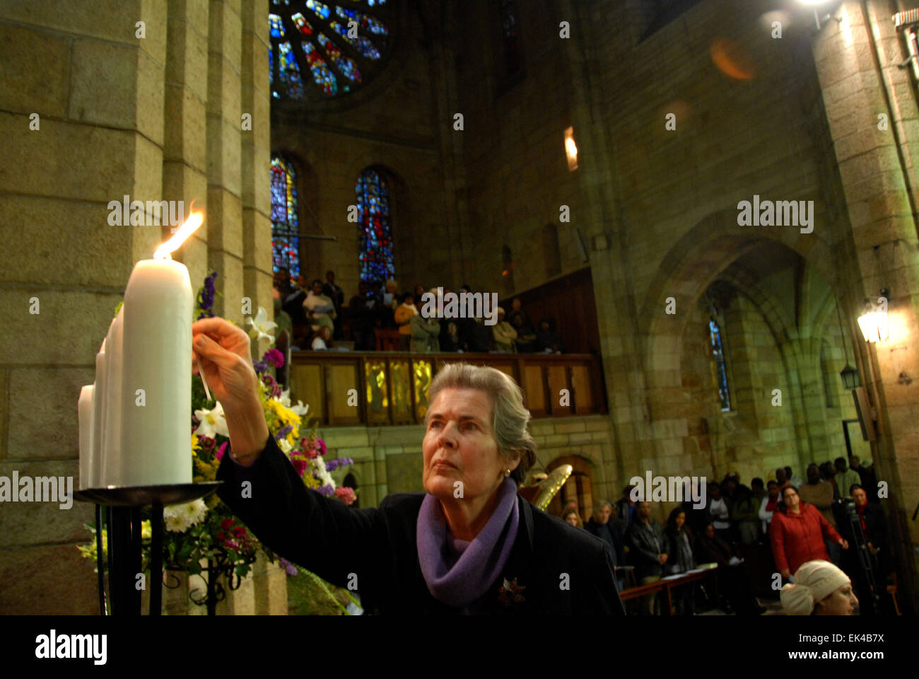 Mary Burton lights candles at commemoration service for 1989 Peace March, St George's cathedral,sept 2009. - Stock Image