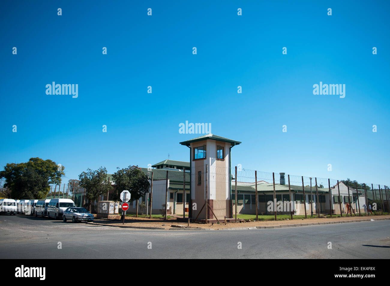 an outside view of the mafikeng prison with a warch tower still intact. its design is colonial.a statue of cecil - Stock Image
