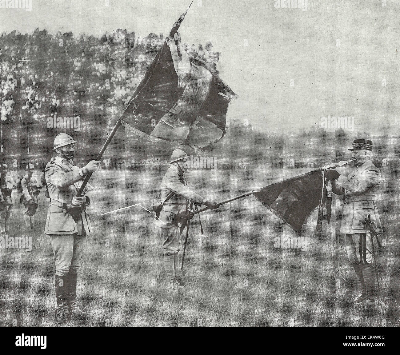 General Petain, the defender of Verdun, is here seen decorating the flag of one of the heroic French Regiments under - Stock Image