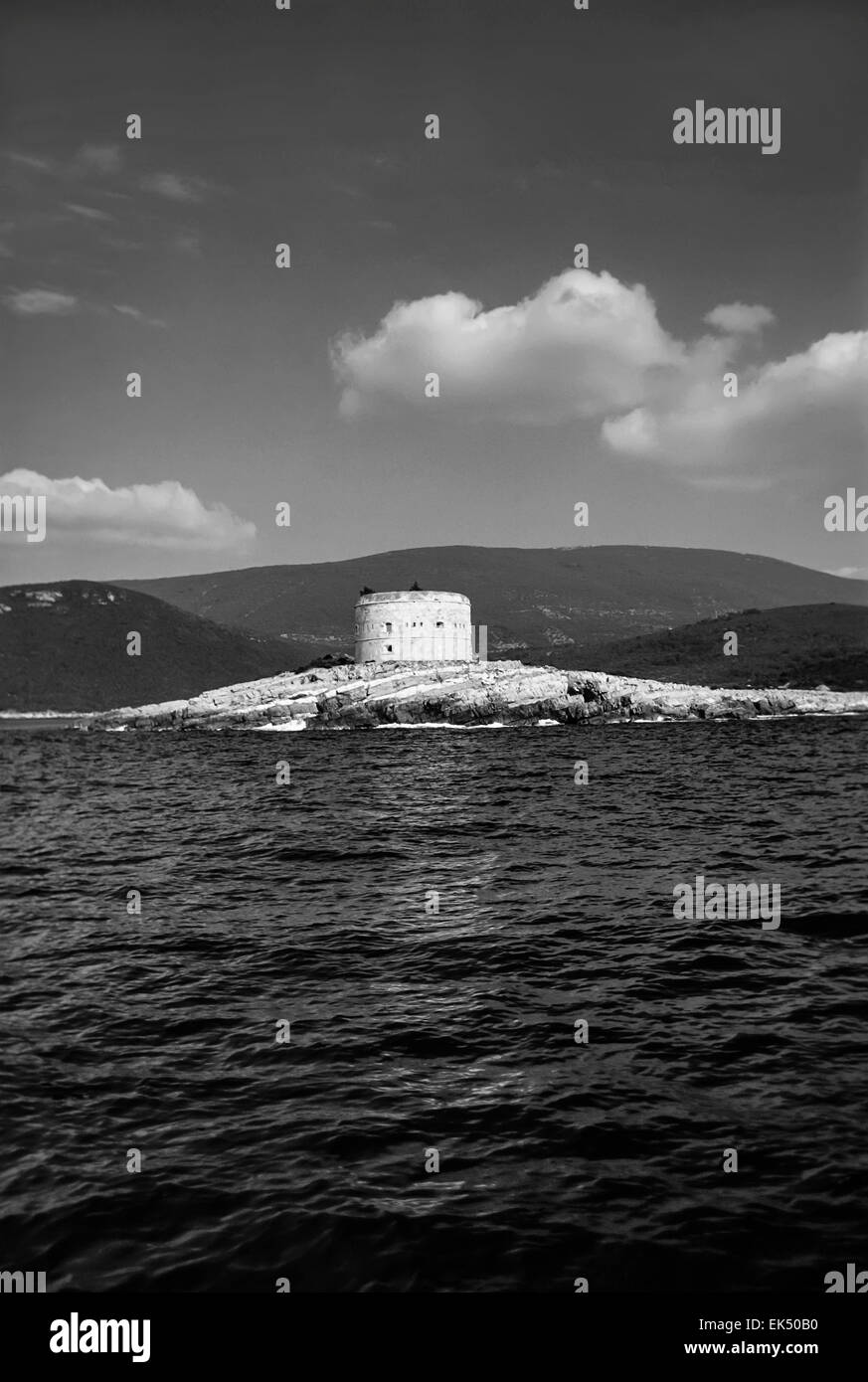 Montenegro, Adriatic Sea, view of the coastline and an old Saracin tower - FILM SCAN - Stock Image