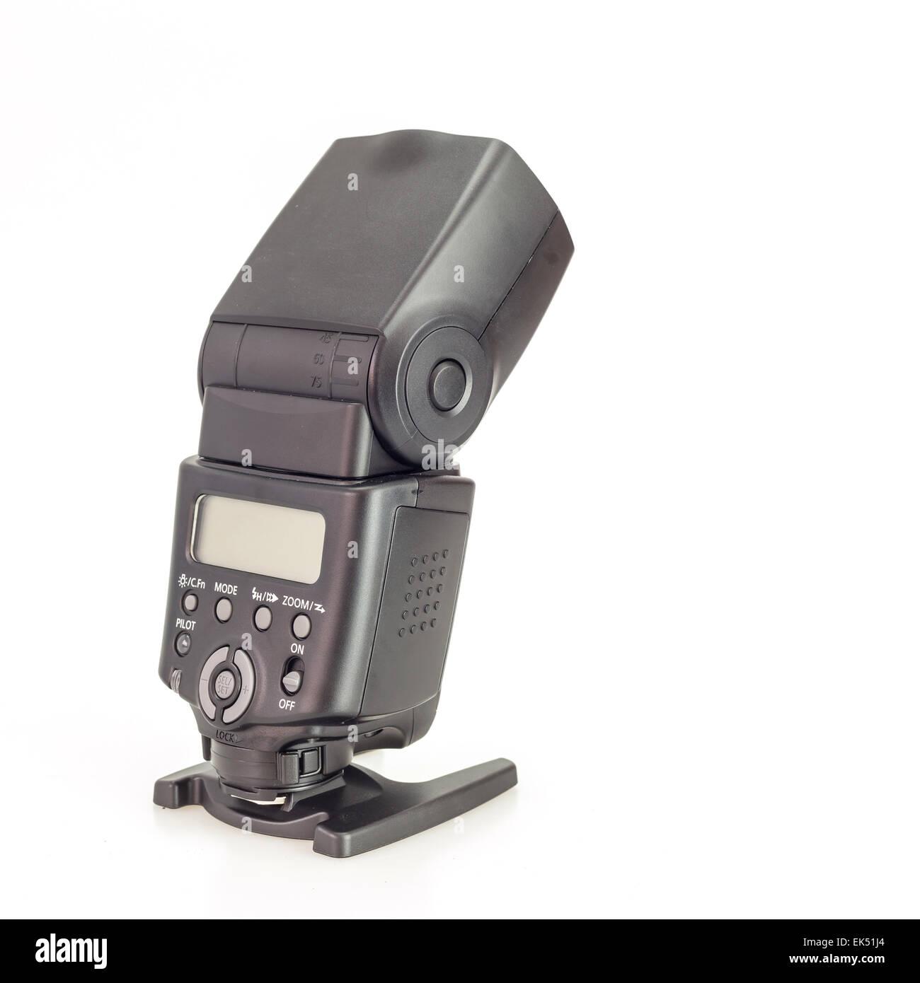 camera speedlight flash over white background - Stock Image