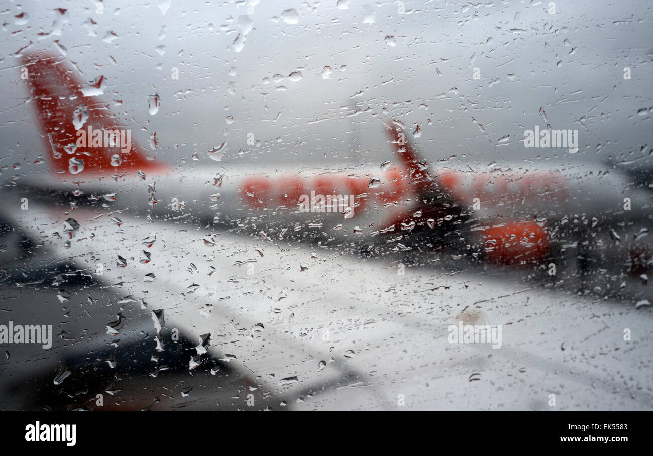Rain droplets on passenger aircraft window, London Stansted Airport UK - Stock Image