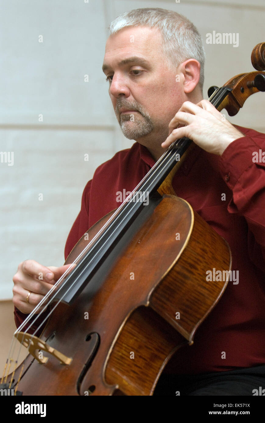 Man playing the Cello at a charitable music concert to support aspiring musicians and composers, Farnham, Surrey, - Stock Image