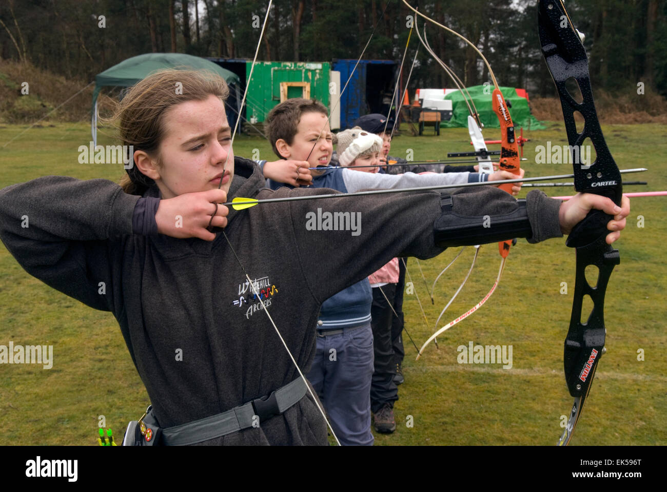 Children in the Under 14 age category take aim in an annual summer archery shoot, Whitehill, Bordon, Hampshire, - Stock Image