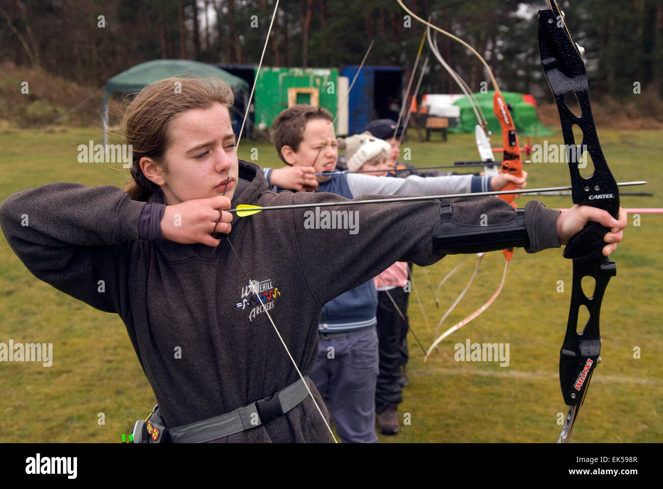 Children in the Under 14 age category take aim in an annual summer archery shoot, Whitehill, Bordon, Hampshire, Stock Photo