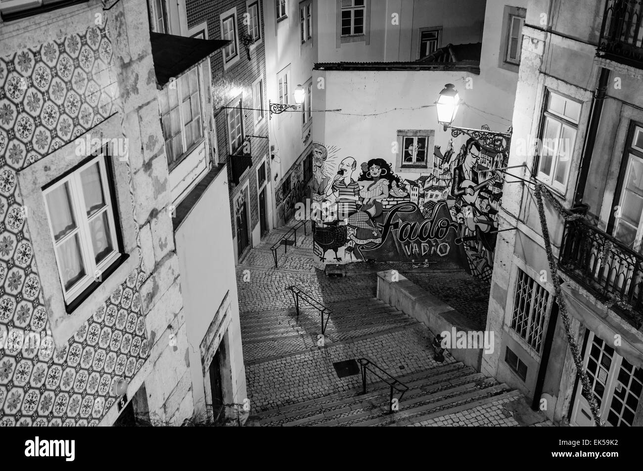Portugal, Lisbon, Alfama area, view of a small street and a Fado mural at night - Stock Image