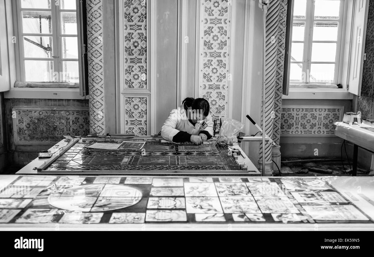 Portugal, Sintra, Pena Palace, a restorer working on an original mosaic glass window - Stock Image