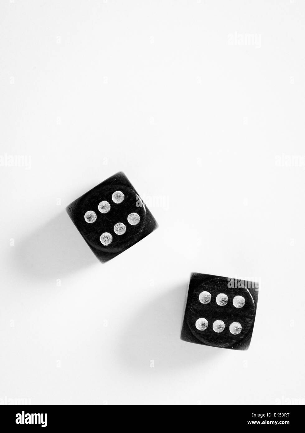 Top view of a pair of black dice on white background with copy space. Double sixes. - Stock Image