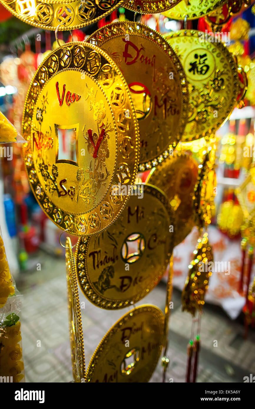 vietnamese new year decoration gold fortune coin - Stock Image