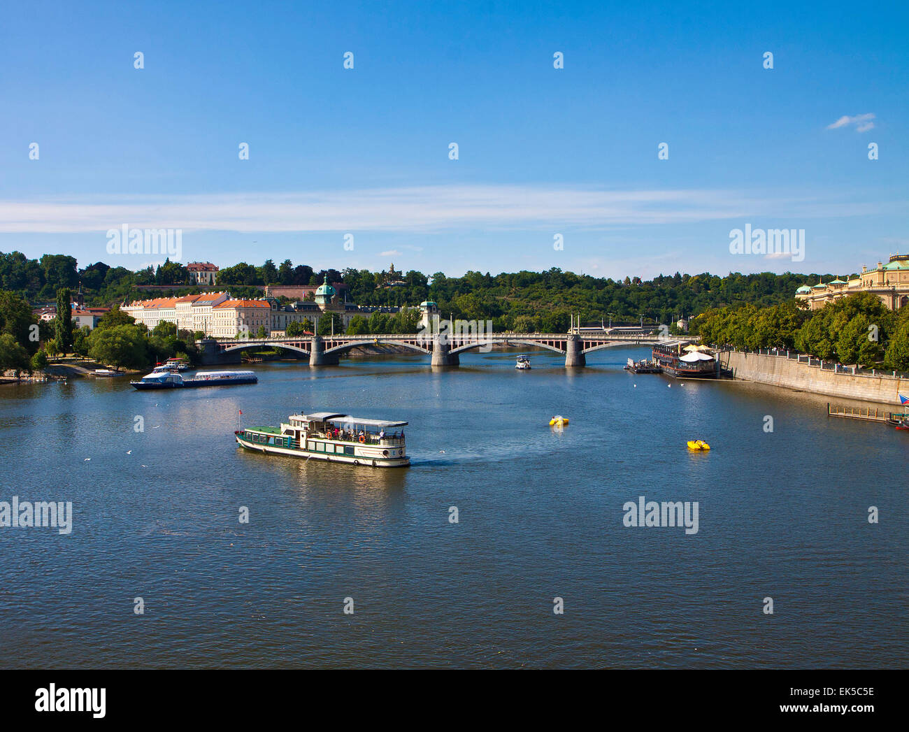 River Moldau at Prague, many cruise ships and boats of every dimensions offer to the  tourists  a beautiful sight - Stock Image