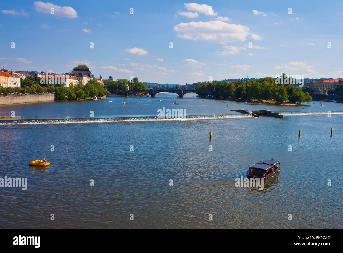 River Moldau at Prague: many small boats  cruise its water and  offer to the tourists  a beautiful view of the city - Stock Image