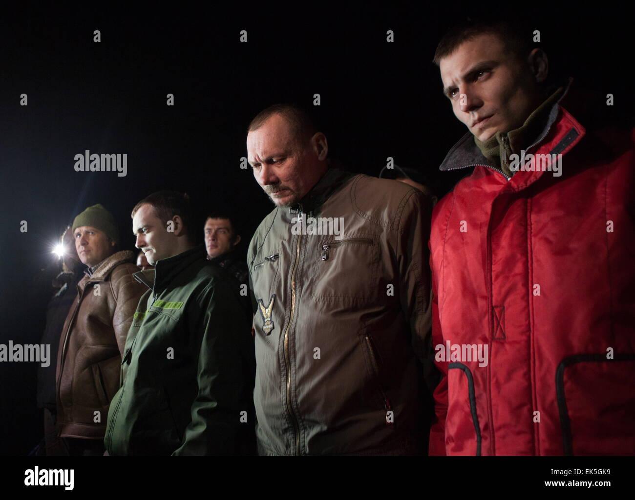 Donetsk Region, Ukraine. 6th Apr, 2015. Captured Ukrainian security officials seen during a handover ceremony at - Stock Image