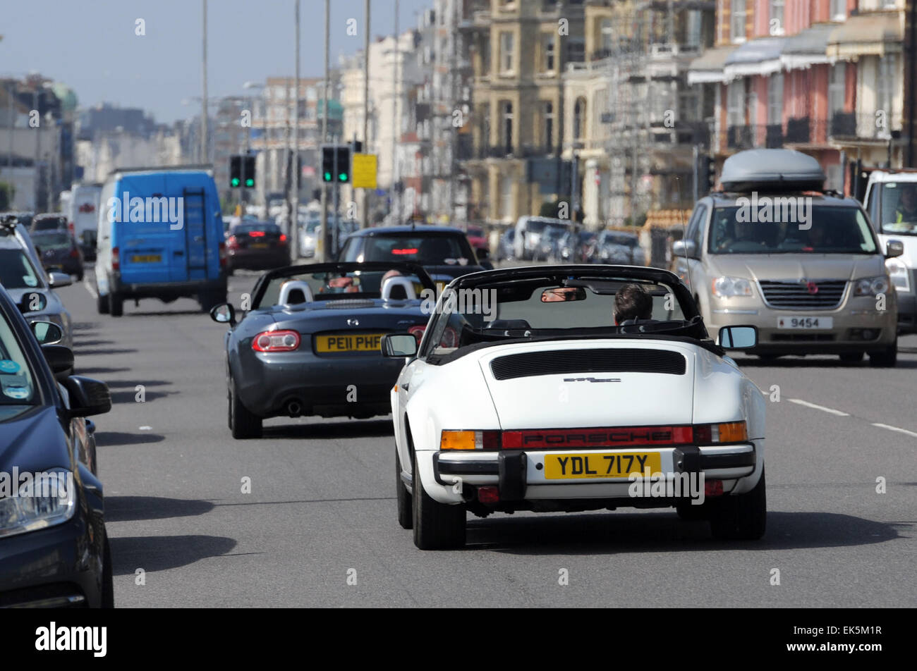 Hove, Brighton, UK. 7th April, 2015. UK Weather: It's time to get the convertibles out for a drive along Hove - Stock Image