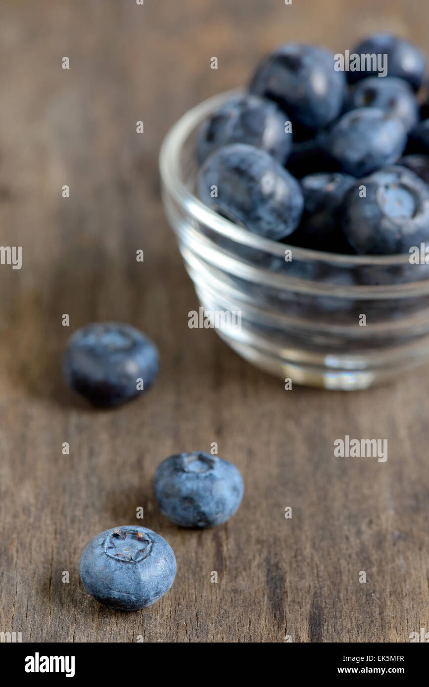 black currant on wooden table - Stock Image