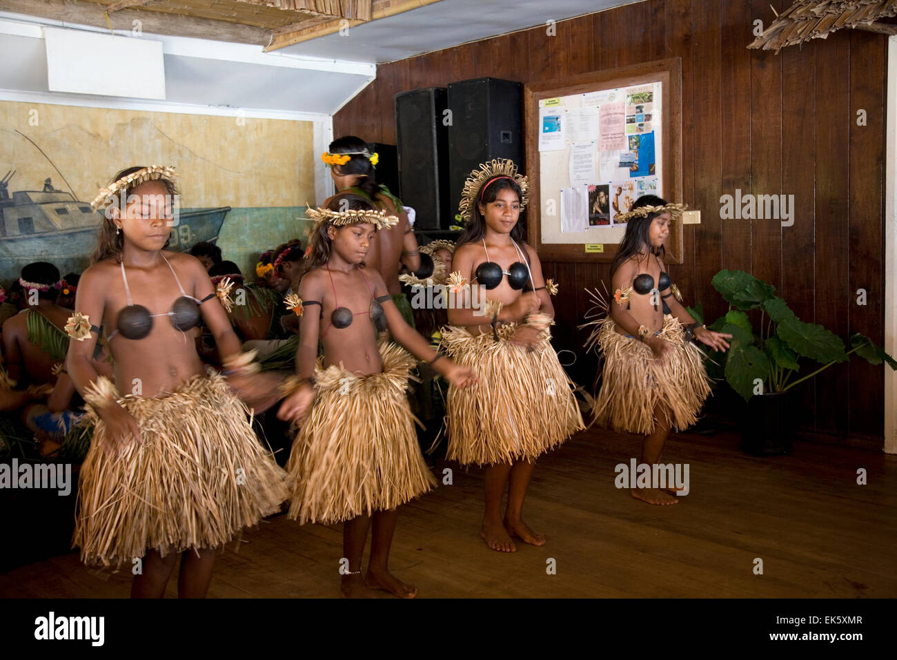 A Gilbert Island dance group performs a Tamure dance at the PT-109 Bar & Restaurant, Gizo Island. - Stock Image