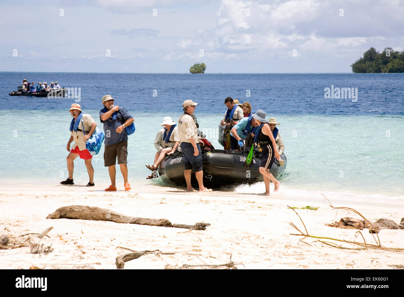 Passengers from the Aussie expedition cruiser Orion arrive by Zodiac on Kennedy Island, a tiny uninhabited Pacific - Stock Image
