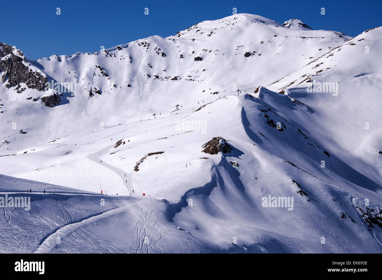 Ski pistes and a chairlift in Mayrhofen ski resort in Zillertal Alps in Tirol, Austria - Stock Image