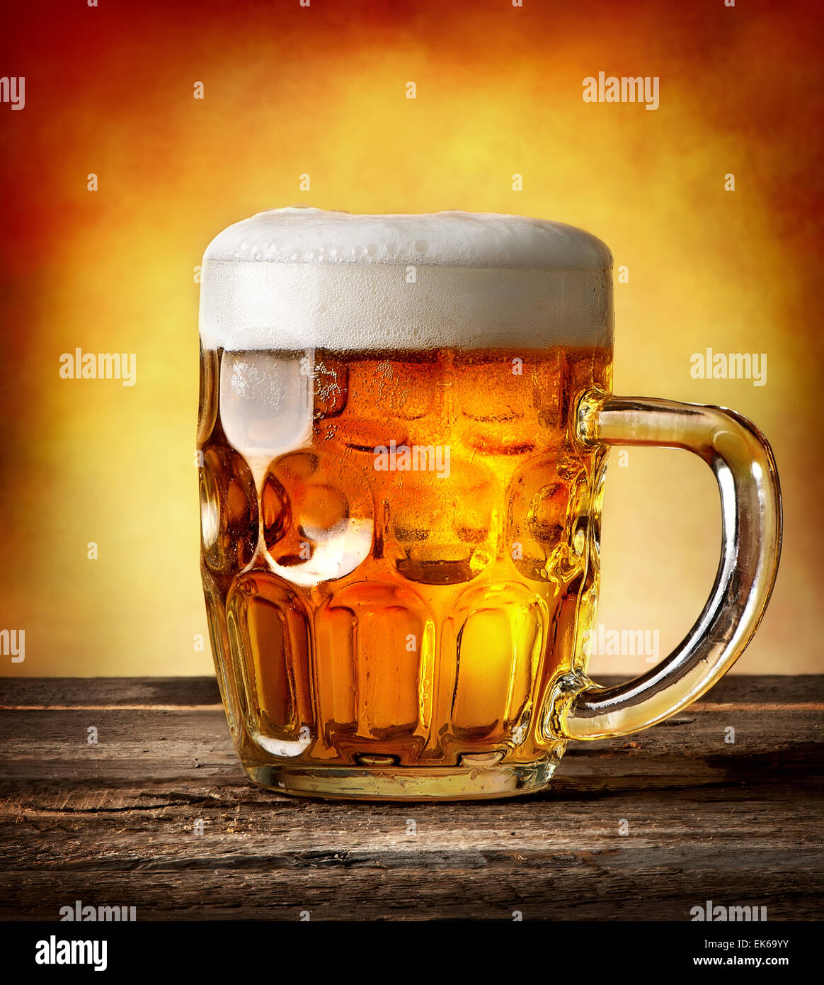 Figured mug of beer on a wooden table Stock Photo